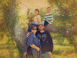 family apple picking autumn fall trees happiness